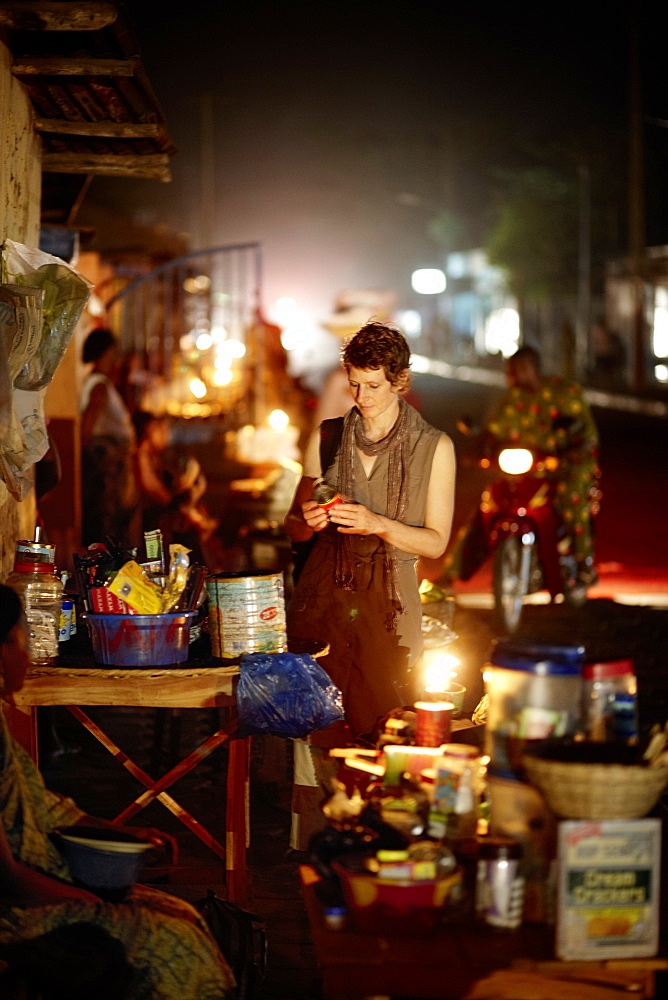 Woman at a night market, Ouidah, Atlantique Department, Benin