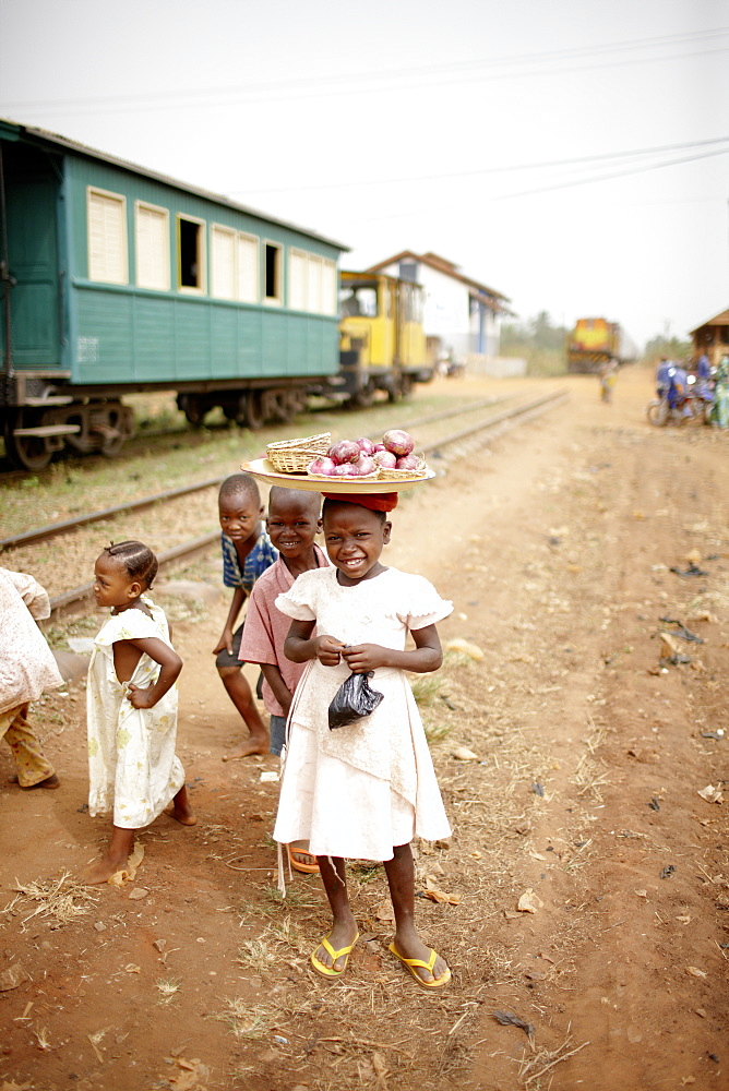 Children beside railroad tracks, between Ouidah and Cotonou, Benin