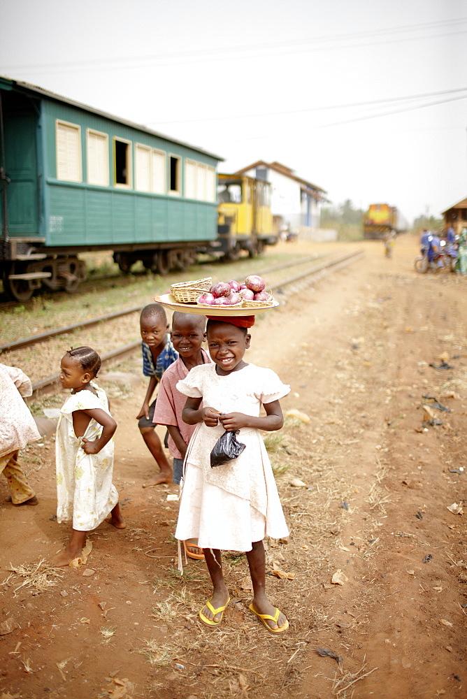 Children beside railroad tracks, between Ouidah and Cotonou, Benin