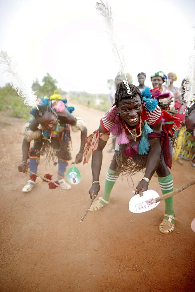 Togolese family dancing and celebrating on street, Taneka-Beri, Benin