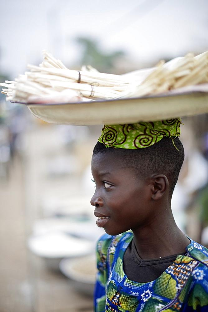 Woman selling softwood to toothbrushing, Dassa market, Benin