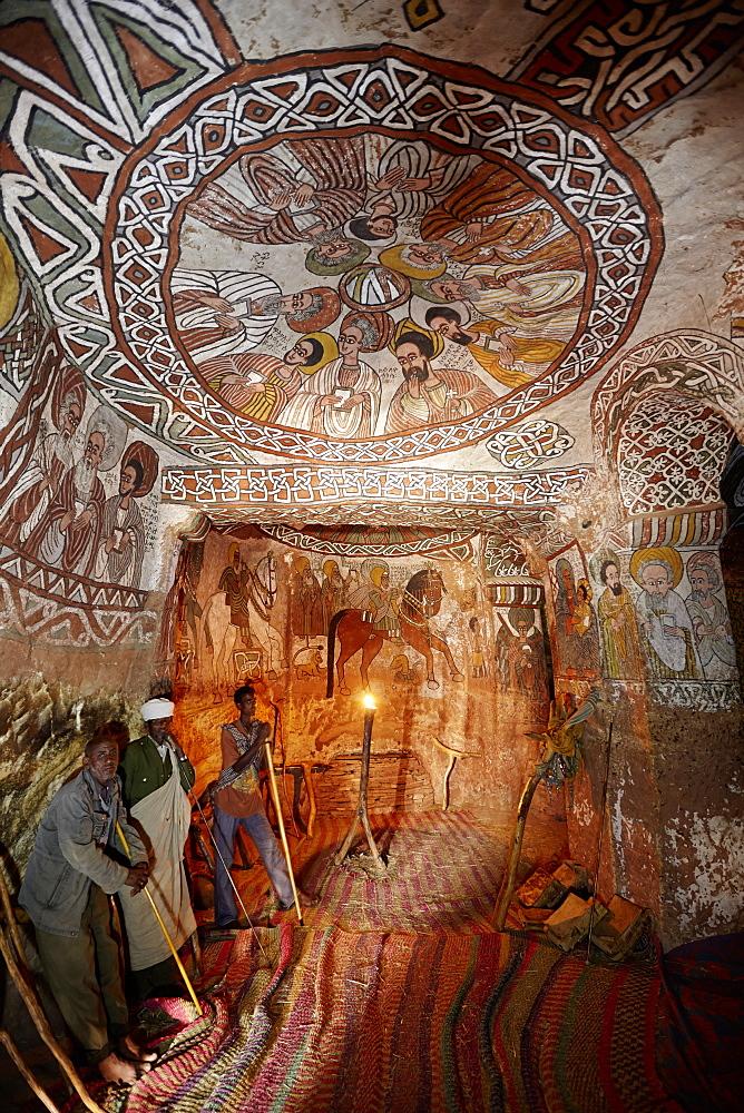 Priests and deacons inside Abuna Yemata Guh church, nine apostles on a fresco, Hawzien, Tigray Region, Ethiopia