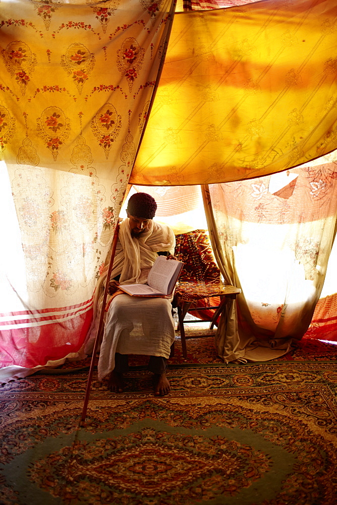 Singing teacher and priest reading a book, monastery Debre Damo, near Adigrat, Tigray Region, Ethiopia