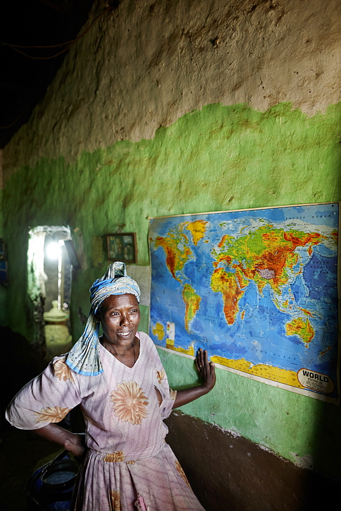 Ethiopian Jewish woman in front of a world map, Walaka, Amhare region, Ethiopia