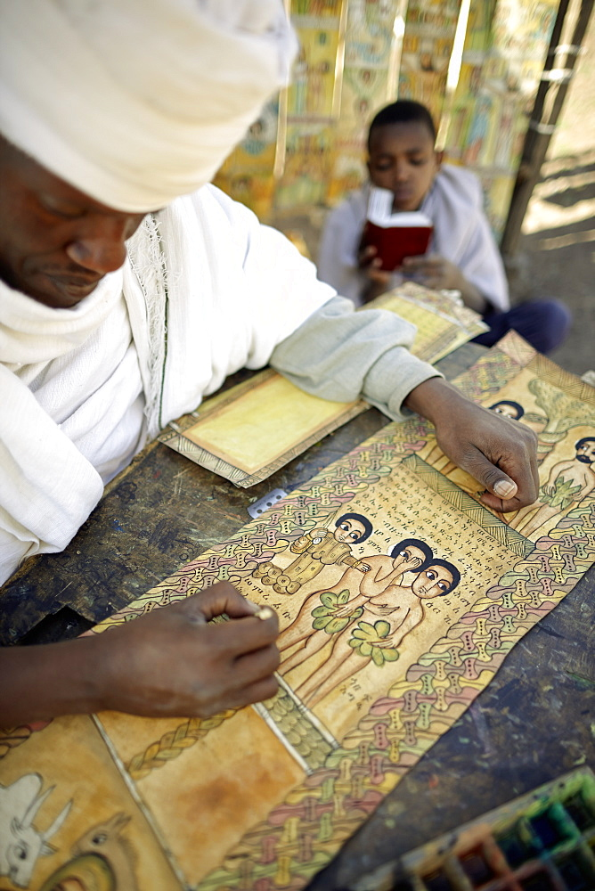 Priest painting and writing biblical scenes in Geez on goatskin, Bet Giyorgis, Church of St. George, Lalibela, Amhara region, Ethiopia
