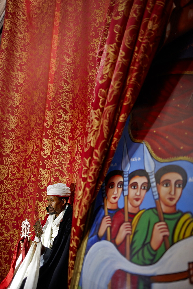Priest holding Lalibela cross, Church of Saint George, Lalibela, Amhara region, Ethiopia