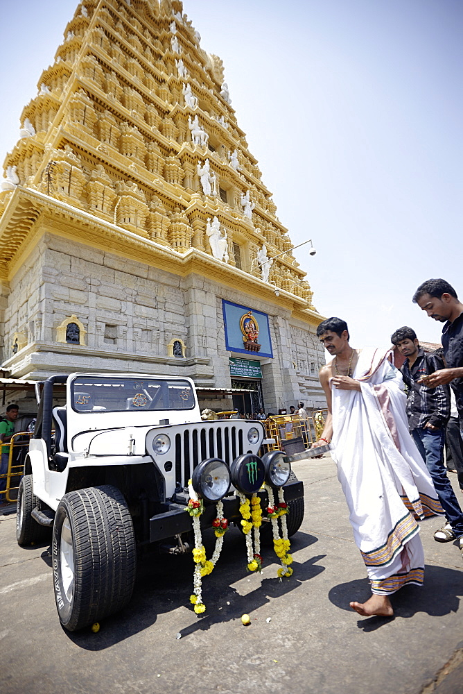 Priest blessing a jeep, Chamundeshwari Temple, Mysore, Karnataka, India