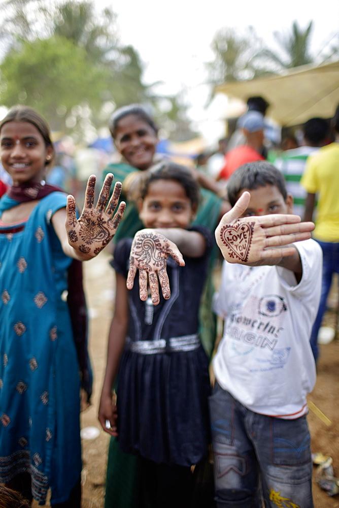 Children with henna painted hands, Angadehalli Belur, Karnataka, India