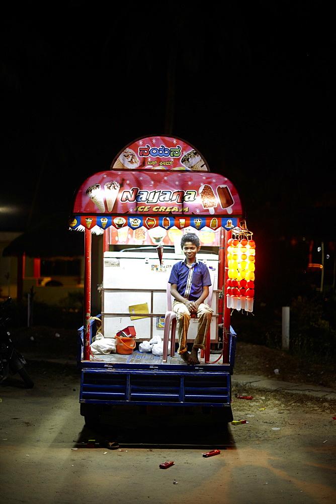 Boy selling ice cream, Malpe Beach, Udipi, Karnataka, India