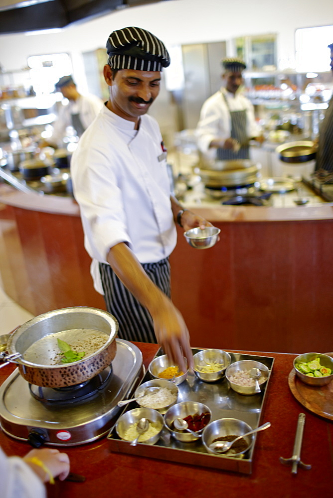 Chef showing ingredients in a hotel restaurant, Gokarna, Karnataka, India