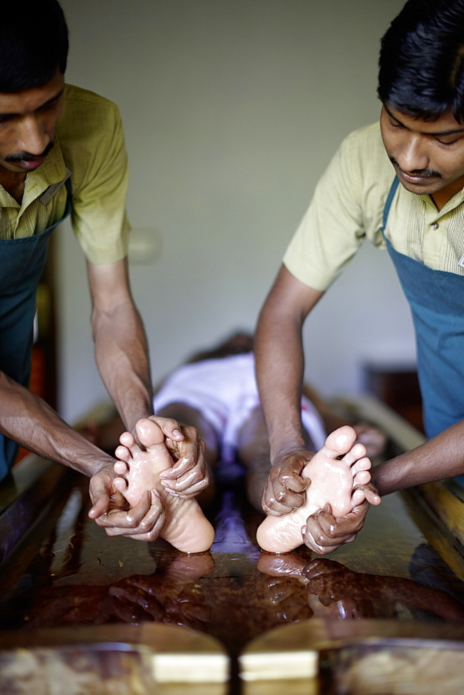 Ayurvedic foot massage in a hotel spa, Gokarna, Karnataka, India