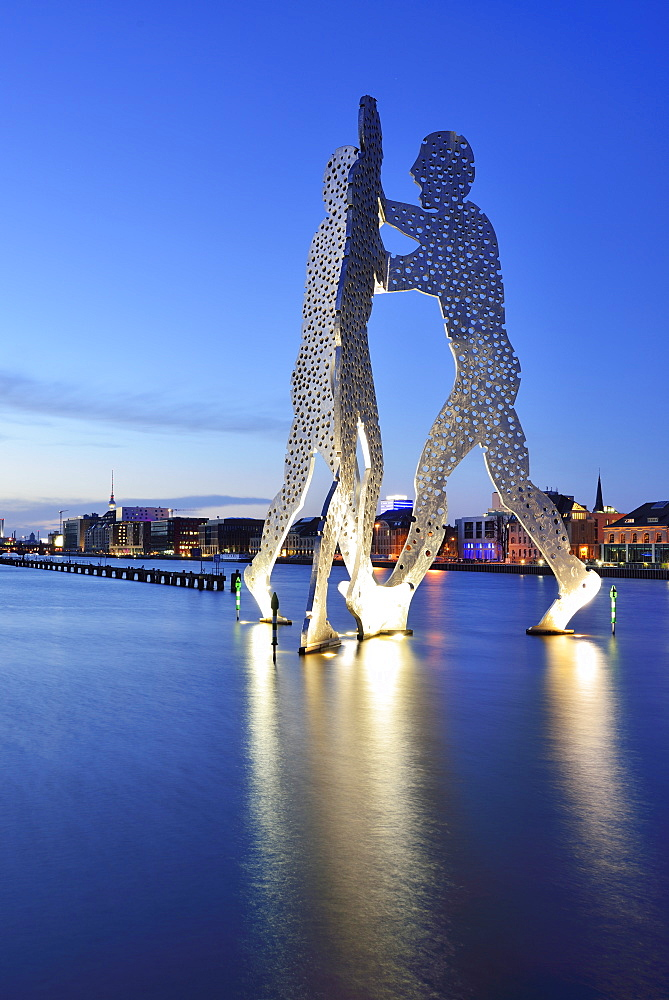 Illuminated artwork Molecule Man above the river Spree, artist Jonathan Borofsky, Berlin, Germany