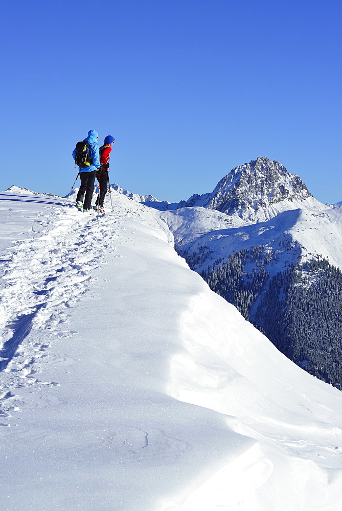Two female back-country skiers ascending to mount Steinberg, Kitzbuehel Alps, Tyrol, Austria