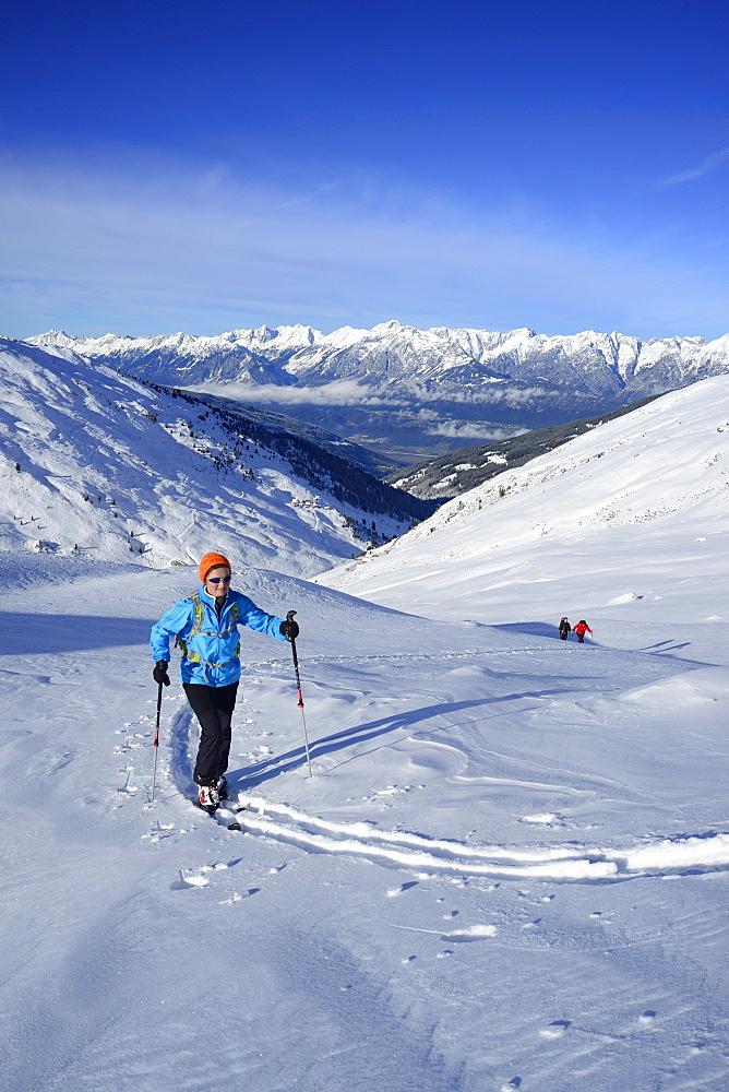 Female back-country skier ascending to Kleiner Gilfert, Karwendel in background, Kleiner Gilfert, Tux Alps, Tyrol, Austria