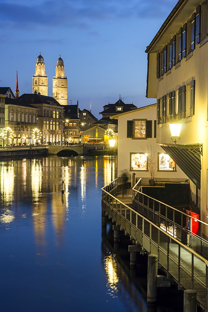 River Limmat and Grossmunster at dusk, Zurich, Switzerland