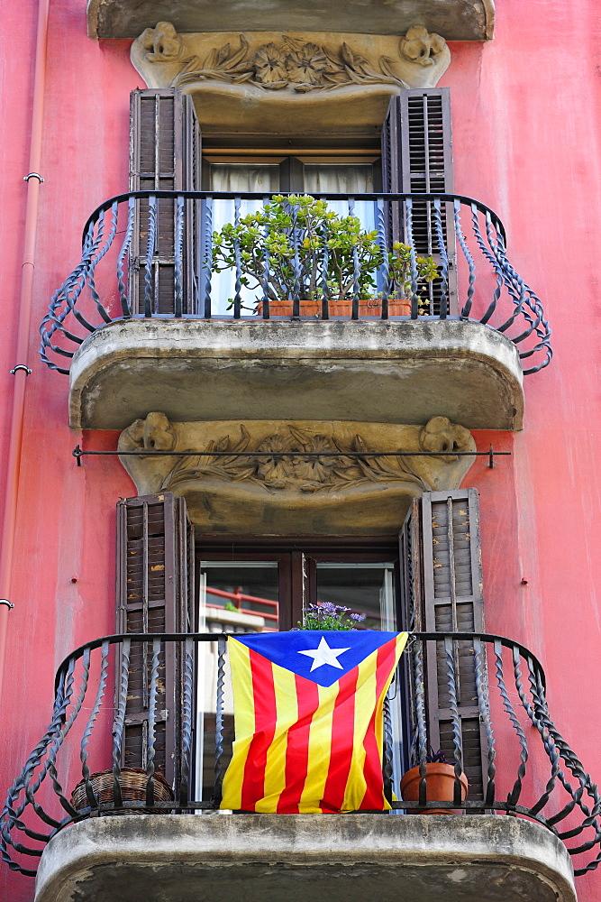 Art Nouveau balcony with ensign, Carrer Gran de Gracia, Gracia, Barcelona, Catalonia, Spain