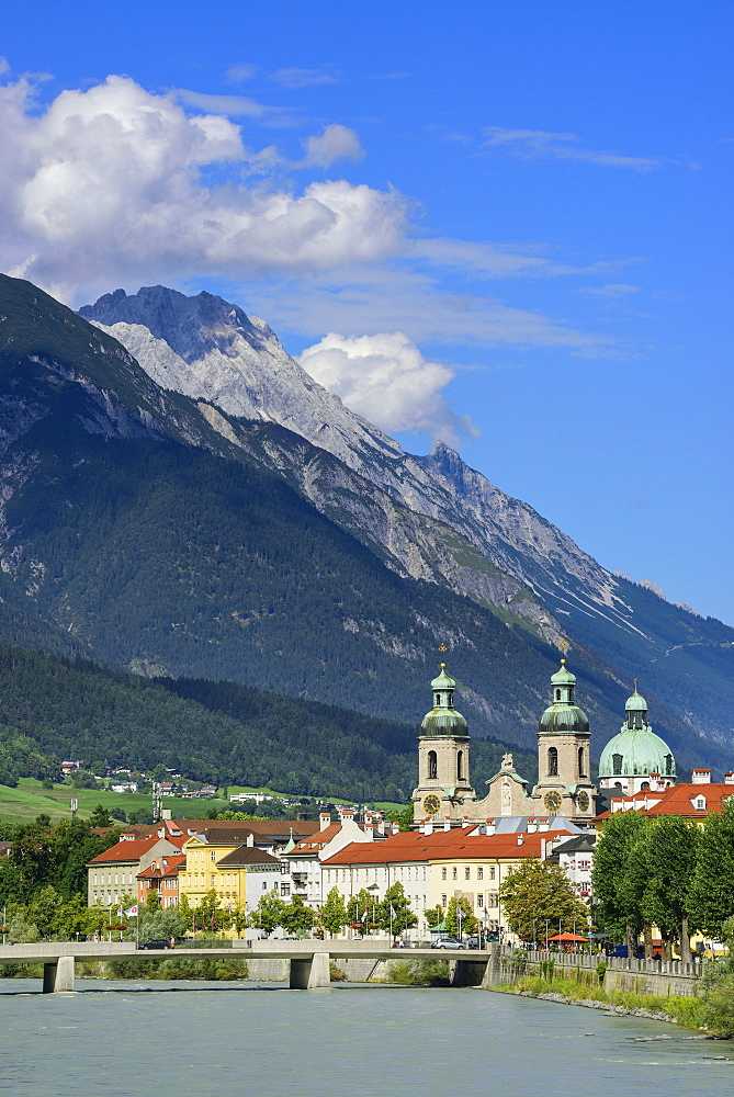 View over Inn river to Cathedral of St. James, Karwendel with mount Bettelwurf in background, Innsbruck, Tyrol, Austria