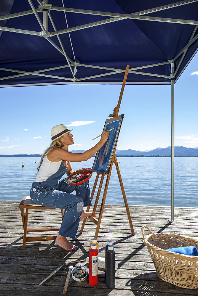 Young Woman with artist's easel, Fraueninsel, Chiemsee, Bavaria, Germany
