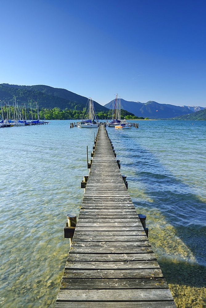 Jetty and sailing boats at lake Tegernsee, Bavarian Alps, Upper Bavaria, Bavaria, Germany
