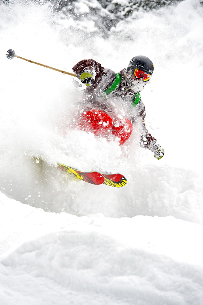 Closeup of a skier in the woods skiing in fresh powder snow, Gerlos, Zillertal, Austria