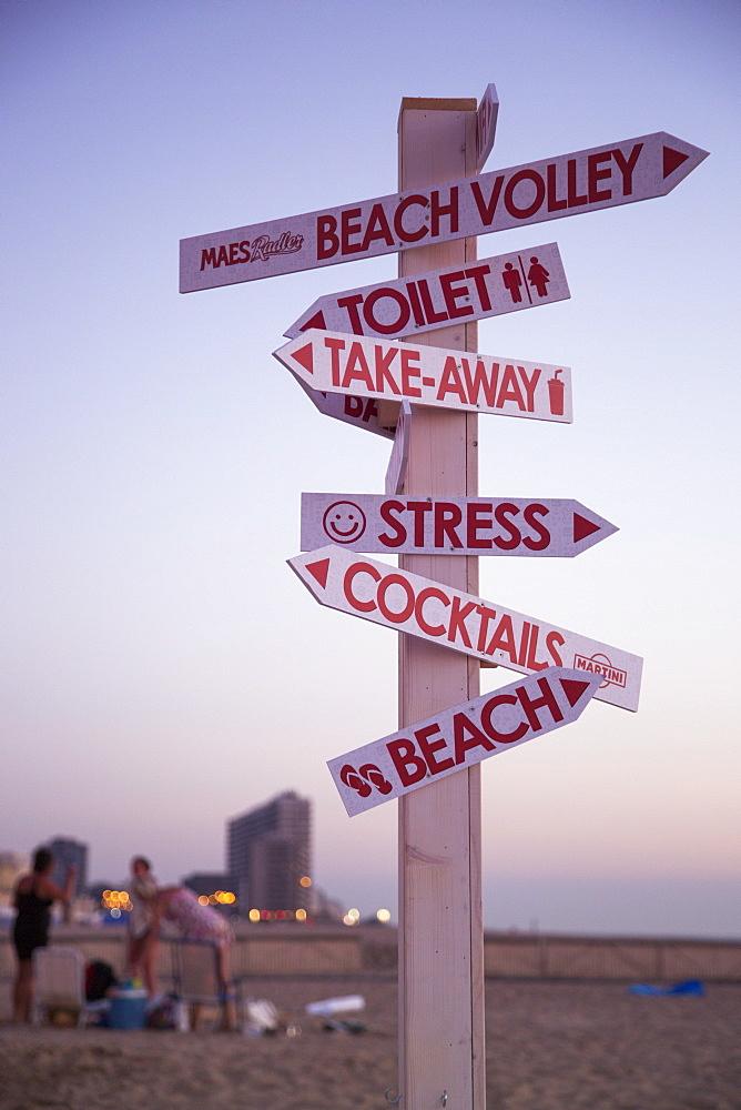 Cheeky signpost near the beach bar, Ostend, Flanders, Flemish Region, Belgium
