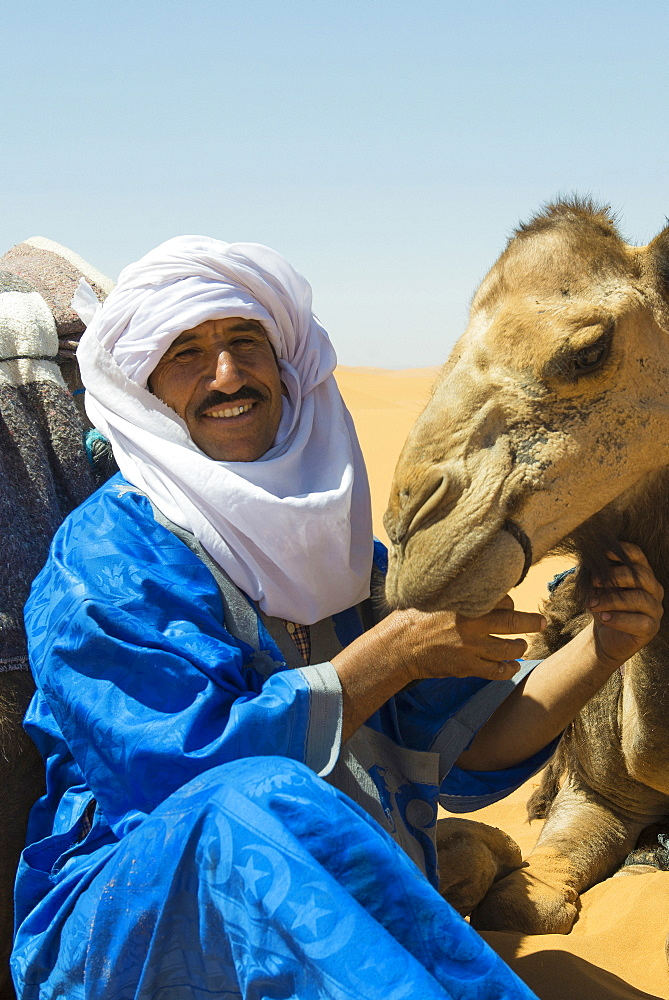 man in traditional clothes and dromedary, Erg Chebbi, Sahara Desert, Morocco, Africa