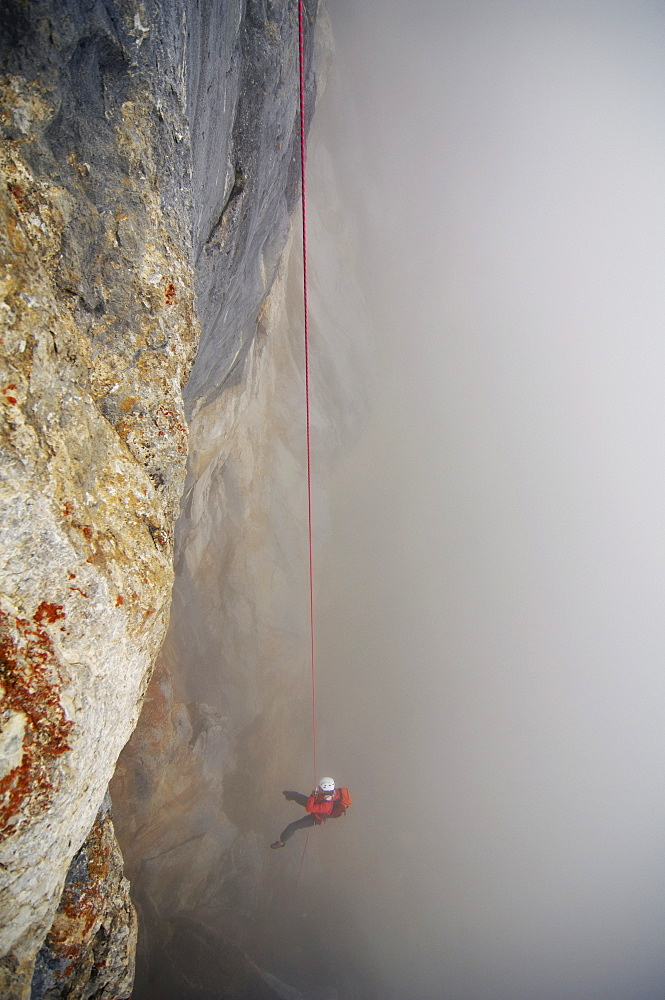 Climber roping in the fog, Tyrol, Austria, Europe - 1113-103284