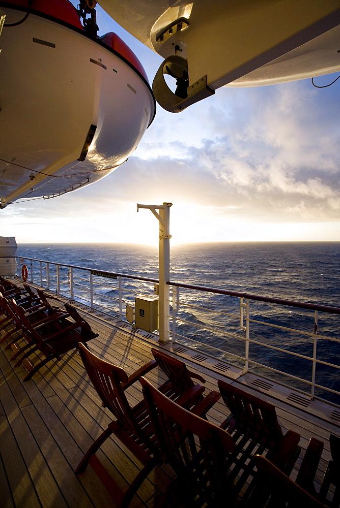 Promenade deck with deck chairs at sunset, Cruise liner Queen Mary 2, Transatlantic, Atlantic ocean - 1113-103377