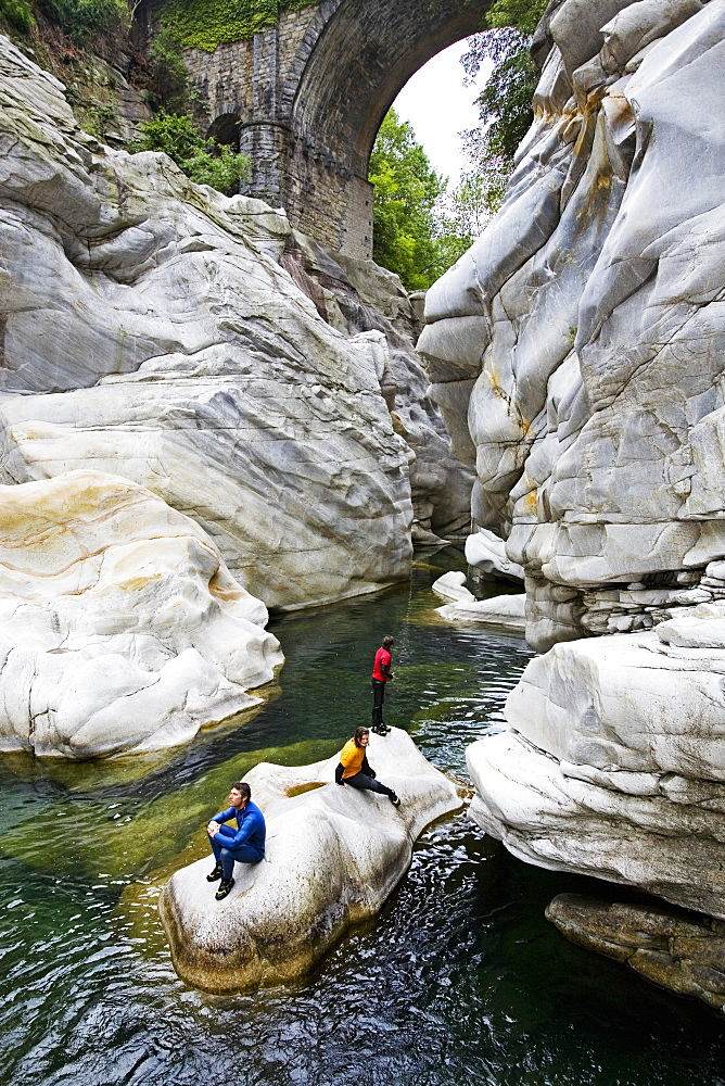 Young woman canyoning, Valle Maggia, Canton of Ticino, Switzerland, MR - 1113-103825