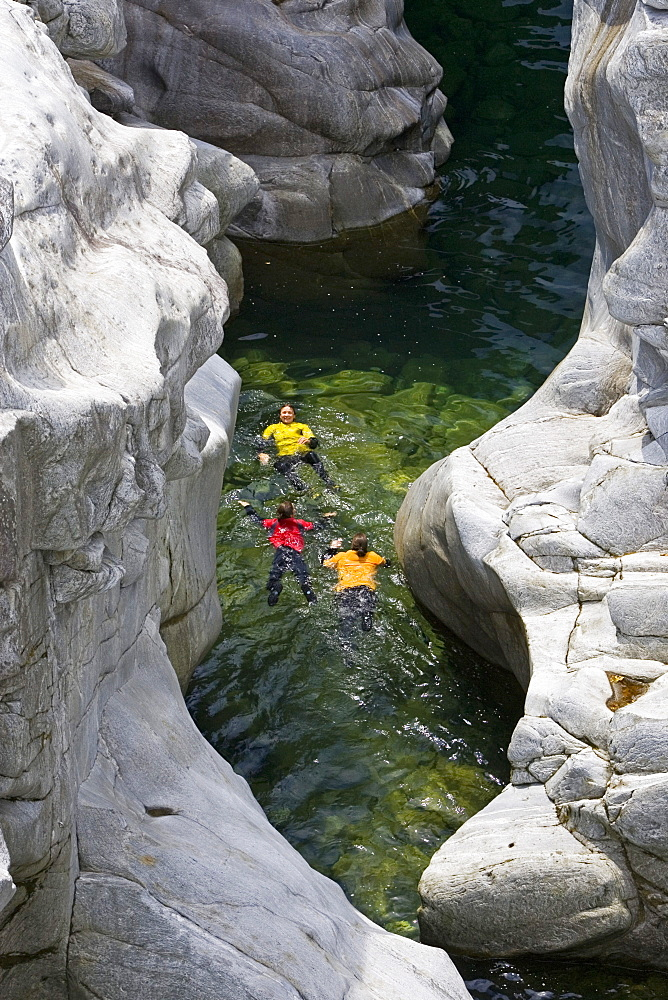 Young woman canyoning, Valle Maggia, Canton of Ticino, Switzerland, MR - 1113-103827