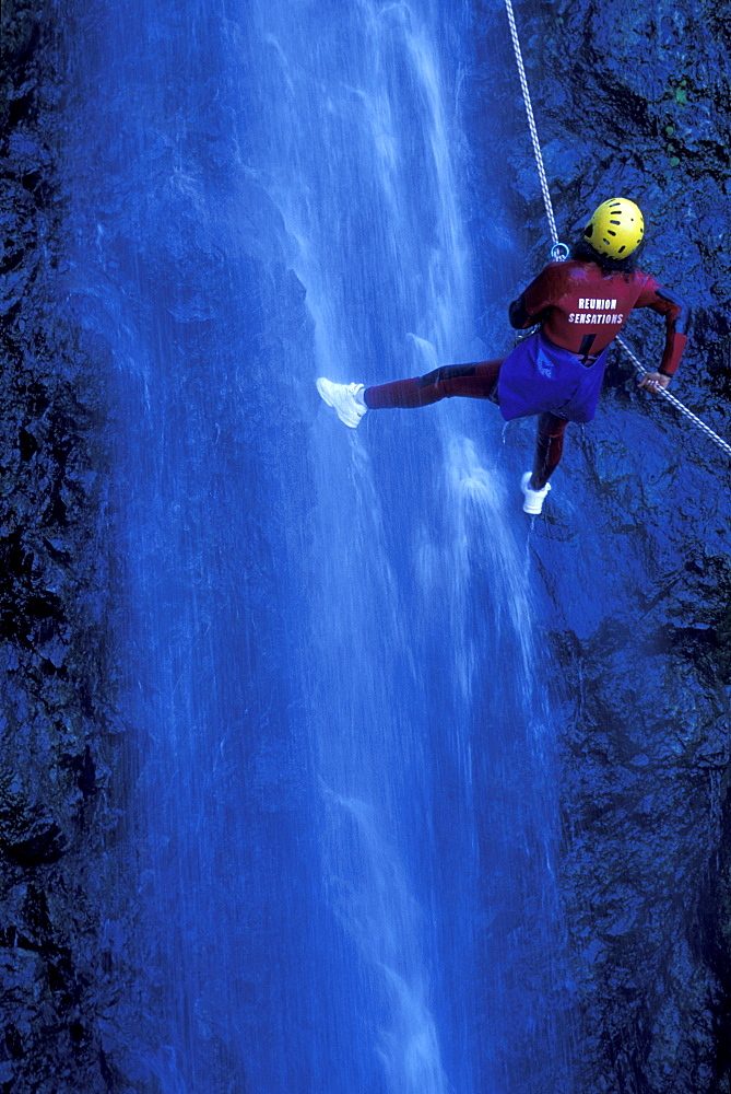 Person canyoning at Gobert Waterfall, Cilaos, La Réunion, Indian Ocean - 1113-104000