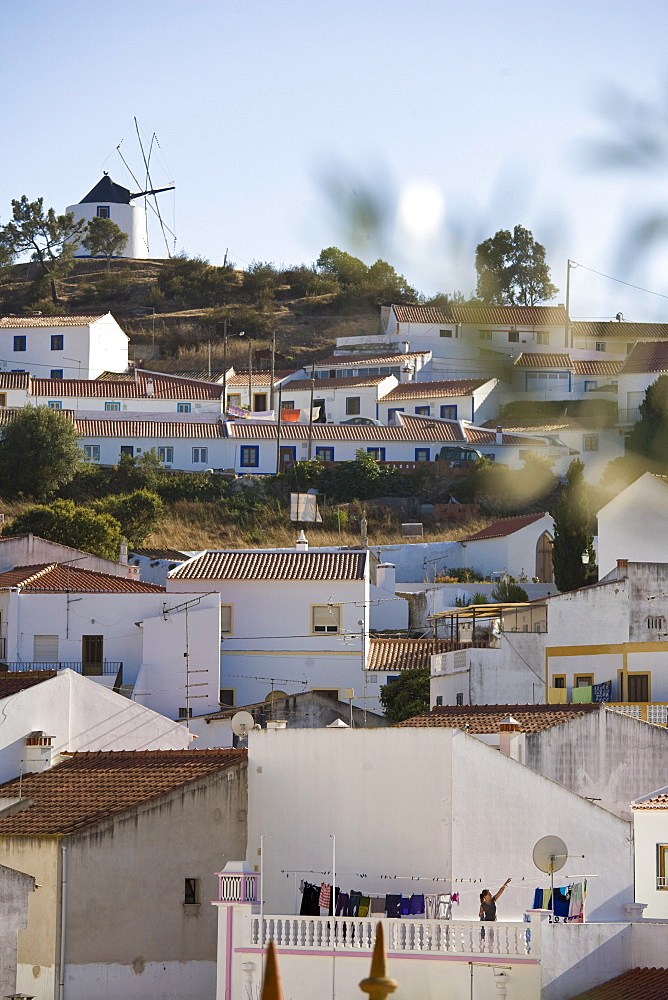 View of the village, windmill and white painted houses on a hill, Odeceixe, Algarve, Portugal