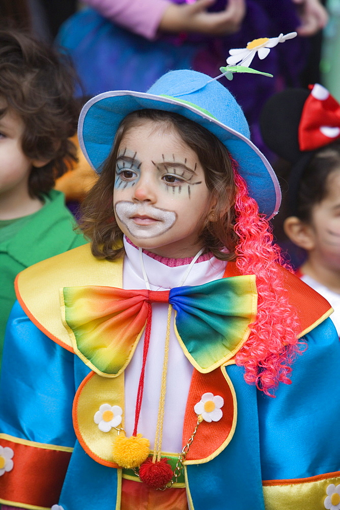 Girl dressed up as a clown at Carnival, Funchal, Madeira, Portugal