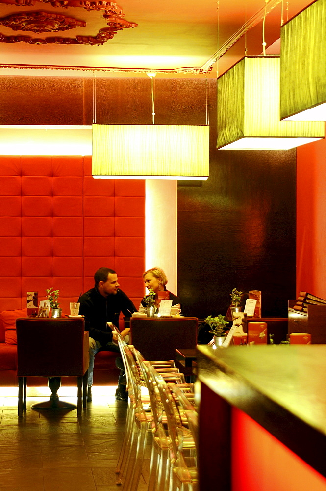 A couple sitting at a table at cafe Felber, Gdansk, Poland, Europe