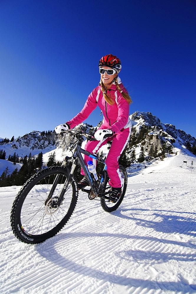 Snow biking, Chiemgau, Bavaria, Germany