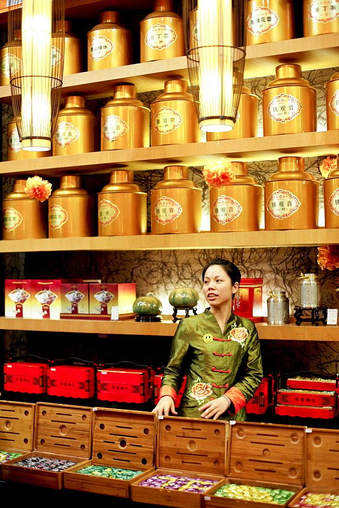 Young saleswoman at a tea shop, Xiamen, Fujian province, China, Asia