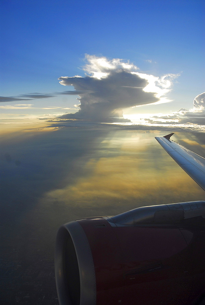 Wing and turbine in front of monsoon cloud above northern India, India, Asia