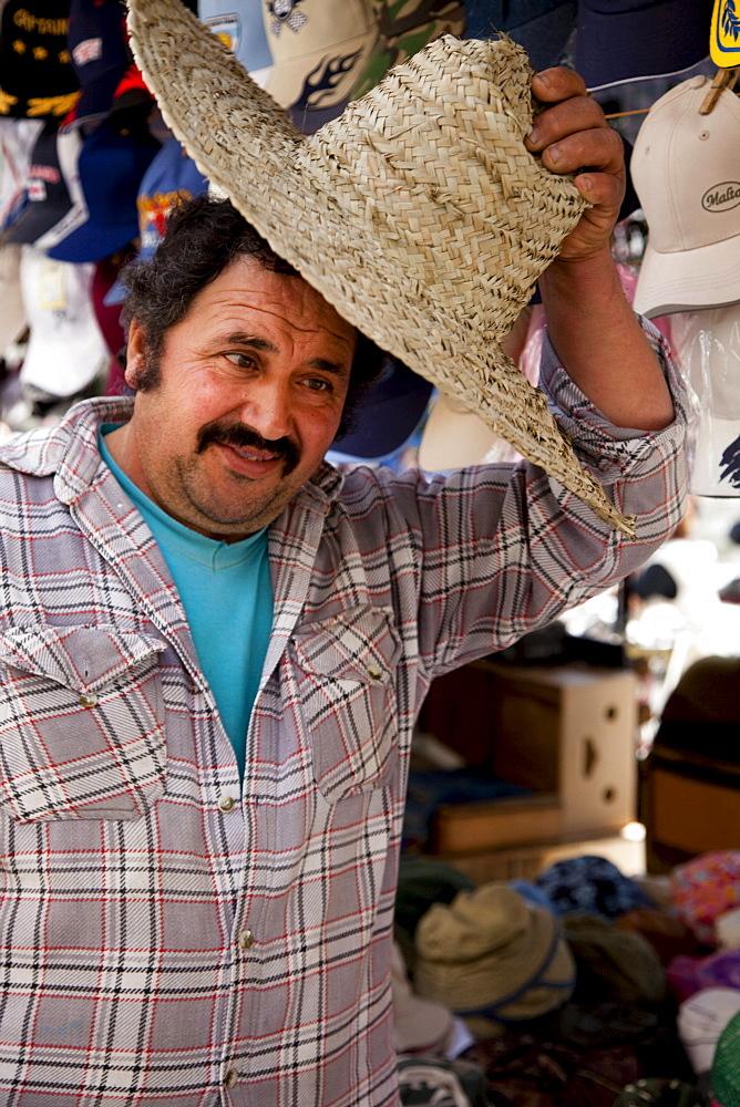 A vendor with a traditional maltese hat, Victoria, Gozo, Malta, Europe