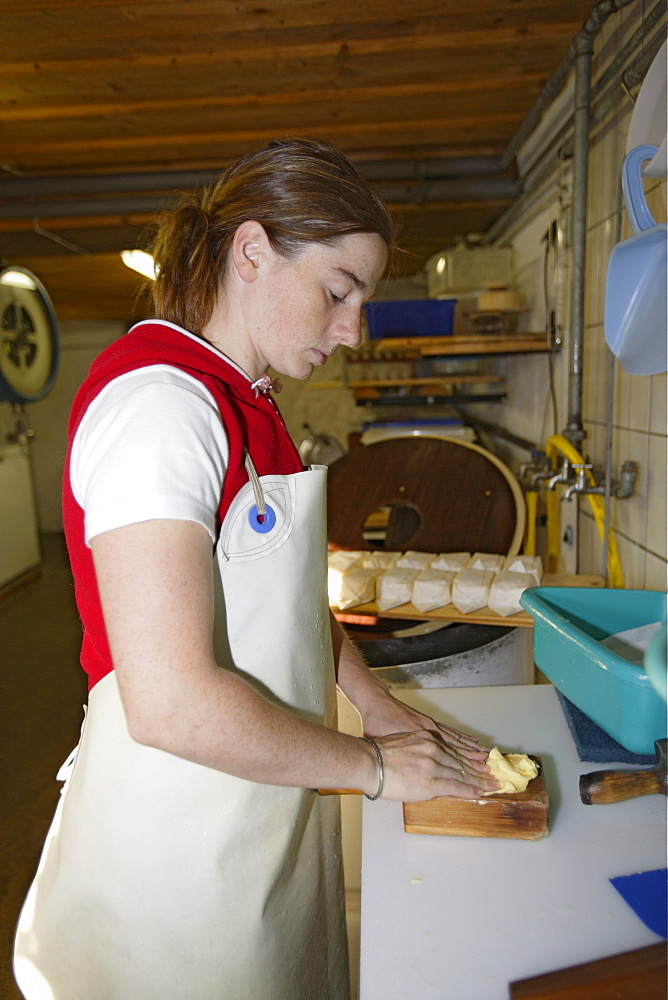 Producing butter at the Laufbichl Alpe alpine dairy, Hintersteiner Tal, Bad Hindelang, Allgau, Swabia, Bavaria, Germany