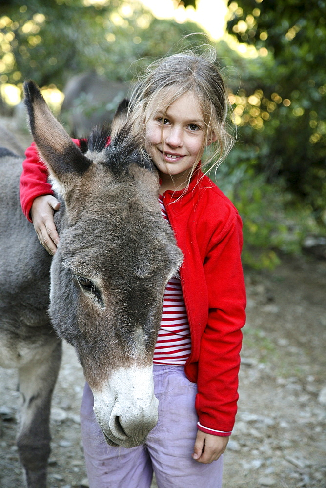 The girl with the donkey, donkey hiking in the Cevennes, France, Europe