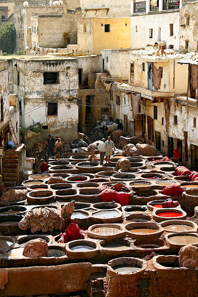 People at a tannery at Chouwara district at the medina of Fes, Morocco, Africa