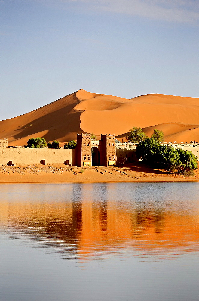 View at Auberge Yasmina at a lake in front of the dunes of Erg Chebbi desert, Morocco, Africa