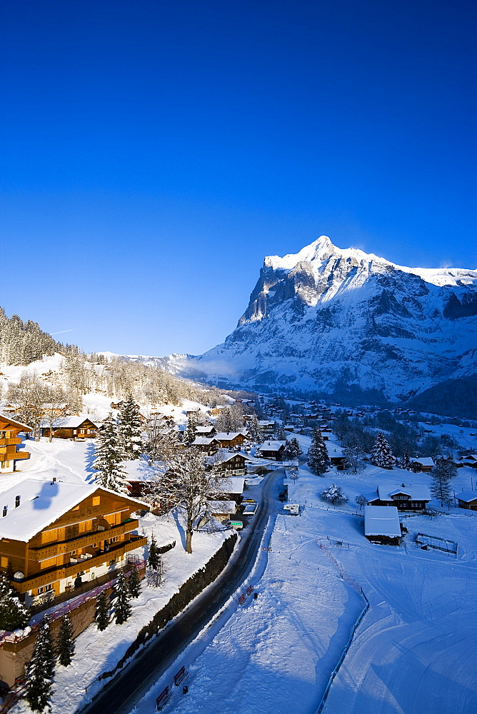View over Grindelwald with mountain Wetterhorn in background, Grindelwald, Bernese Oberland, Canton of Bern, Switzerland