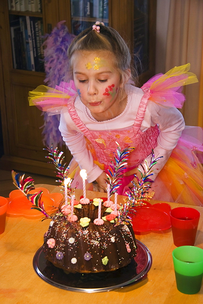 Little girl with birthday cake, Upper Bavaria, Germany