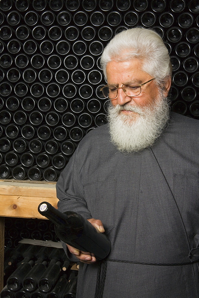 Father Dionysos in a wine cellar, winery, Chrysorrogiatissa monastery, Troodos mountains, South Cyprus, Cyprus