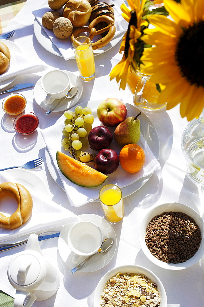 Breakfast table with sunflower in a hotel, Healthy breakfast, South Tyrol, Italy