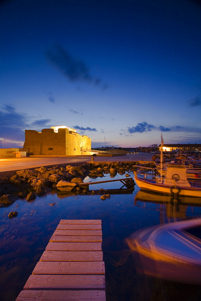Paphos Castle at night with fishing boats, Paphos harbour, Paphos, South Cyprus, Cyprus