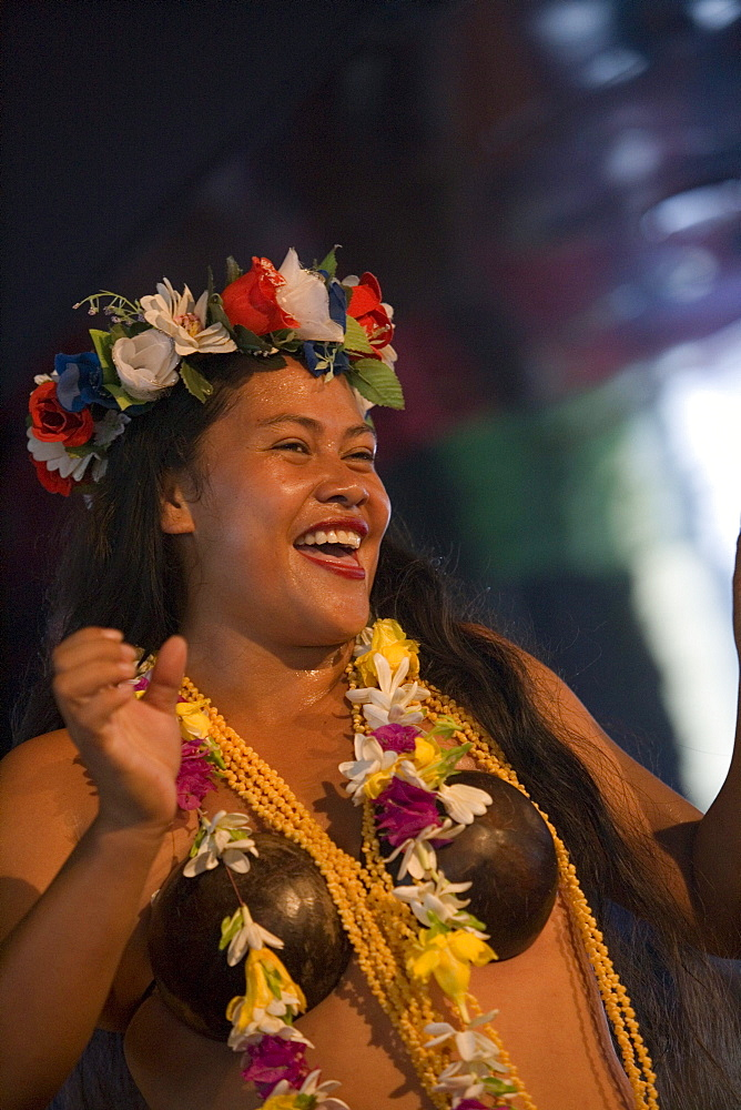 Cheerful polynesian dancer on board of MV Columbus, Aitutaki, Cook Islands, South Pacific, Oceania