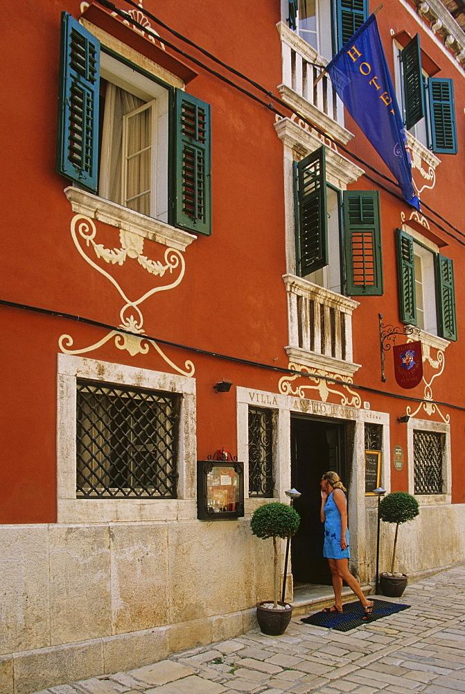 A woman in front of a hotel at Pula, Croatian Adriatic Sea, Istria, Croatia, Europe