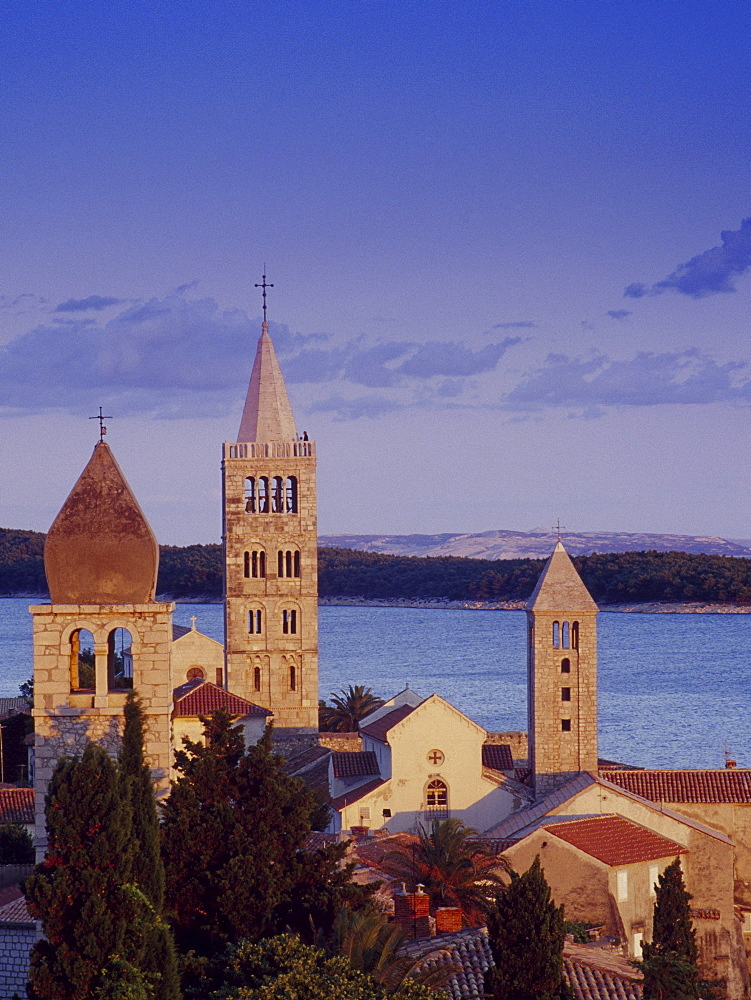 View over Bay of Kvarner and steeples in the light of the evening sun, Rab island, Croatian Adriatic Sea, Dalmatia, Croatia, Europe